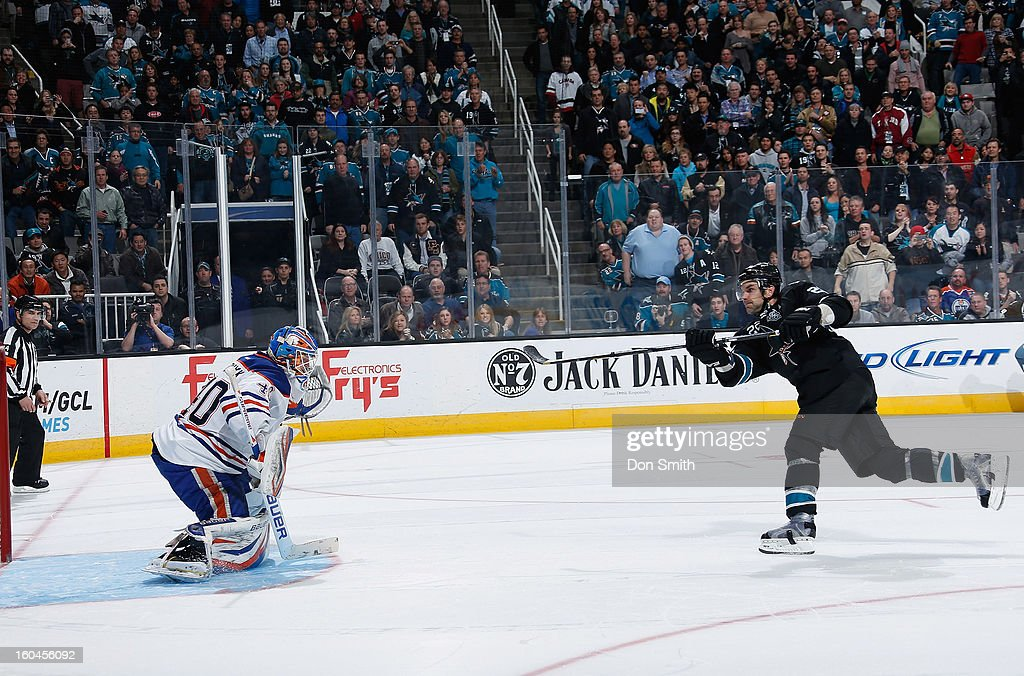 Dan Boyle #22 of the San Jose Sharks scores in a shootout against <a gi-track='captionPersonalityLinkClicked' href=/galleries/search?phrase=Devan+Dubnyk&family=editorial&specificpeople=2089794 ng-click='$event.stopPropagation()'>Devan Dubnyk</a> #40 of the Edmonton Oilers during an NHL game on January 31, 2013 at HP Pavilion in San Jose, California.