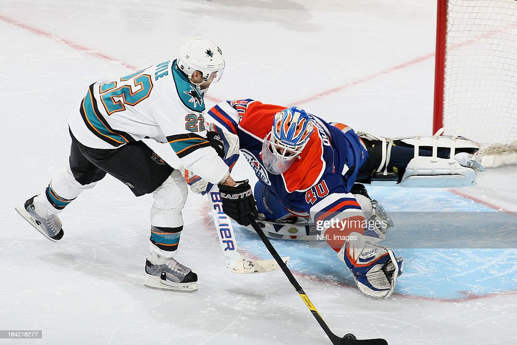 <a gi-track='captionPersonalityLinkClicked' href=/galleries/search?phrase=Dan+Boyle&family=editorial&specificpeople=201502 ng-click='$event.stopPropagation()'>Dan Boyle</a> #22 of the San Jose Sharks scores the game-winning shootout goal on <a gi-track='captionPersonalityLinkClicked' href=/galleries/search?phrase=Devan+Dubnyk&family=editorial&specificpeople=2089794 ng-click='$event.stopPropagation()'>Devan Dubnyk</a> #40 of the Edmonton Oilers on March 20, 2013 at Rexall Place in Edmonton, Alberta, Canada.