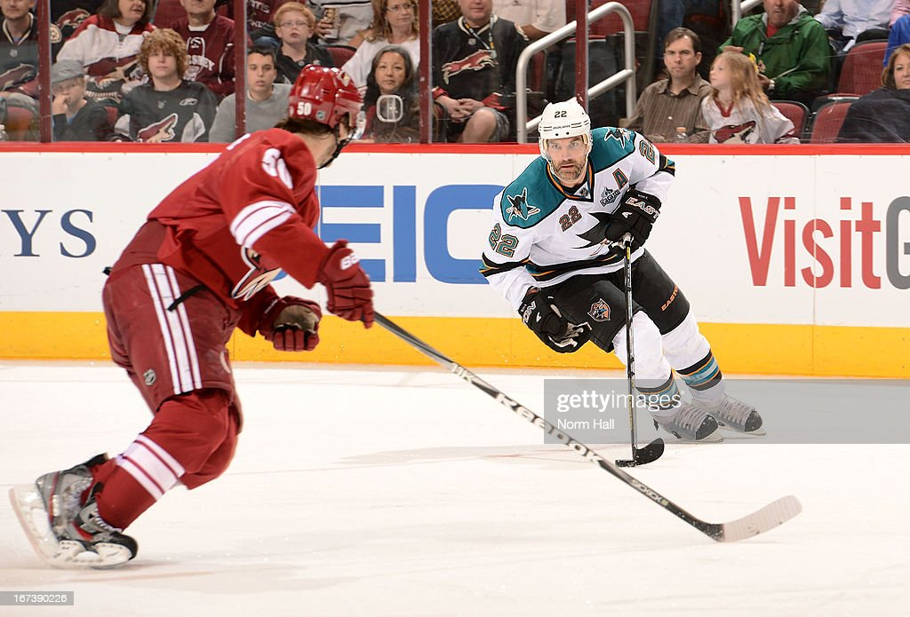 <a gi-track='captionPersonalityLinkClicked' href=/galleries/search?phrase=Dan+Boyle&family=editorial&specificpeople=201502 ng-click='$event.stopPropagation()'>Dan Boyle</a> #22 of the San Jose Sharks skates with puck as <a gi-track='captionPersonalityLinkClicked' href=/galleries/search?phrase=Antoine+Vermette&family=editorial&specificpeople=206302 ng-click='$event.stopPropagation()'>Antoine Vermette</a> #50 of the Phoenix Coyotes defends during the third period at Jobing.com Arena on April 24, 2013 in Glendale, Arizona.