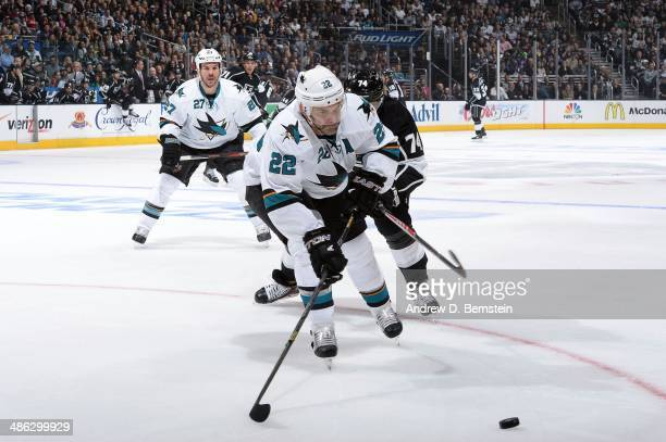 Dan Boyle of the San Jose Sharks skates with the puck ahead of Dwight King of the Los Angeles Kings in Game Three of the First Round of the 2014...