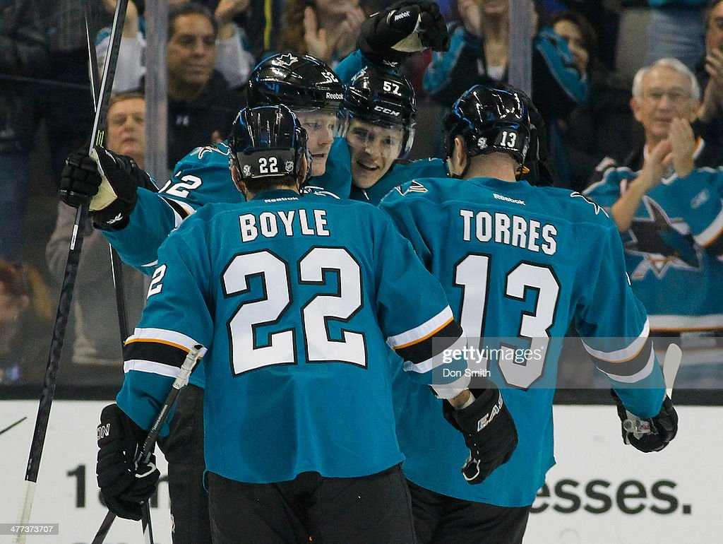 Dan Boyle Raffi Torres Tommy Wingels and Matt Irwin of the San Jose Sharks celebrate a goal against the Montreal Canadiens during an NHL game on...
