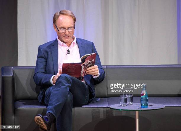 Dan Brown presents his book 'Origin' the 2017 Frankfurt Book Fair on October 14 2017 in Frankfurt am Main Germany The German actor Wolfram Koch reads...