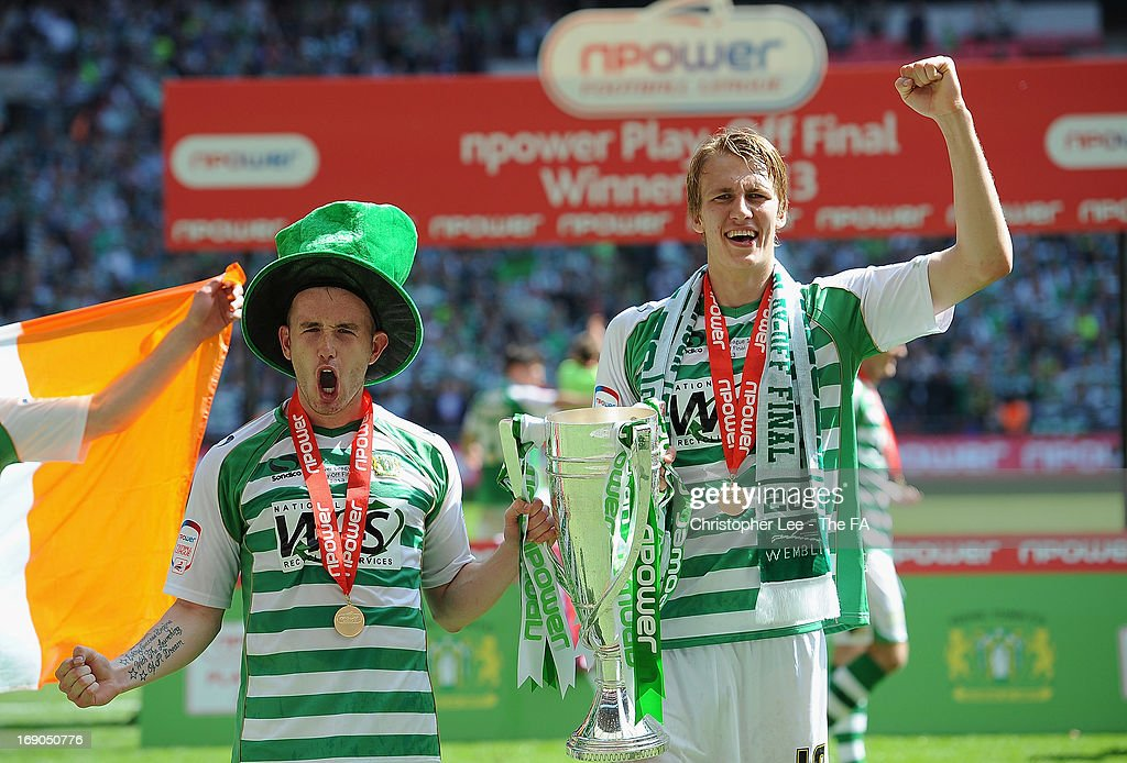 Dan Burn and Patrick Madden of Yeovil Town celebrate with the trophy during the npower League One Play Off Final match bewteen Brentford and Yeovil Town at Wembley Stadium on May 19, 2013 in London, England.