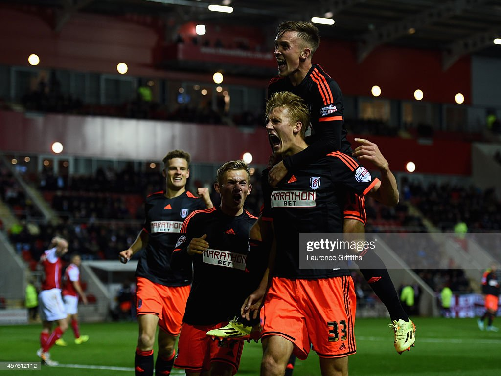 Dan Burn of Fulham celebrates scoring his sides third goal during the Sky bet Championship match between Rotherham United and Fulham at The New York Stadium on October 21, 2014 in Rotherham, England.