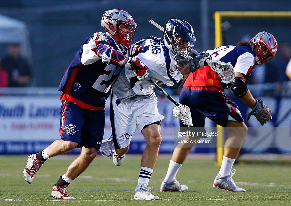 Dan Burns #4 of the Chesapeake Bayhawks has the ball knocked loose by Kevin Buchanan #27 of the Boston Cannons in the first half during the game on May 18, 2013 at Harvard Stadium in Boston, Massachusetts.