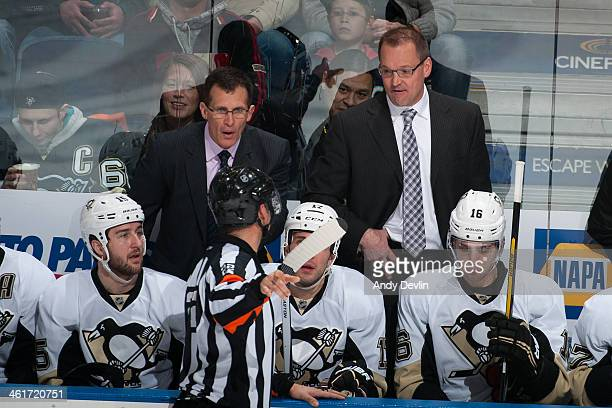 Dan Bylsma and Tony Granato of the Pittsburgh Penguins exchange words with an offical during a game against the Edmonton Oilers on January 10 2014 at...