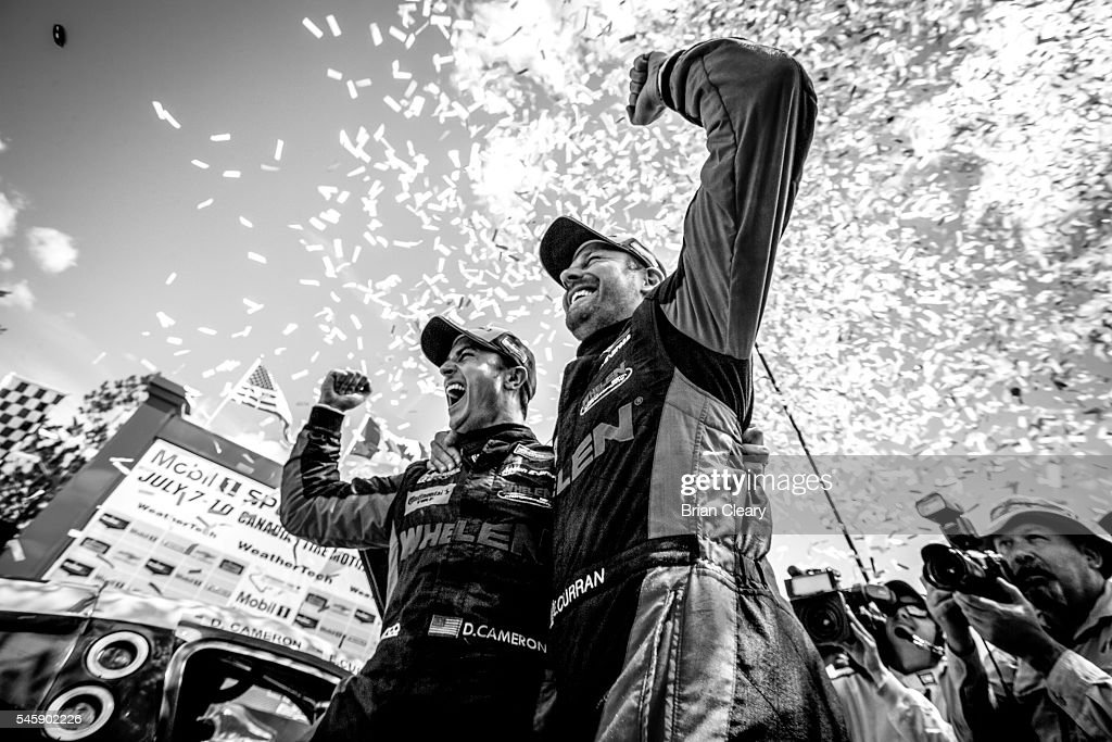 Dan Cameron L and Eric Curran celebrate after winning the IMSA WeatherTech Series race at Canadian Tire Motorsport Park on July 8 2016 in Bowmanville...