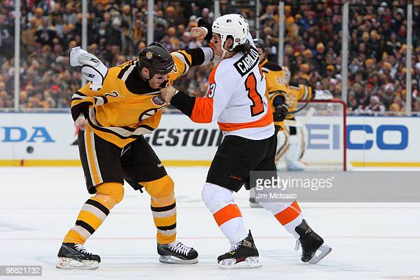 Dan Carcillo of the Philadelphia Flyers fights against Shawn Thornton of the Boston Bruins during the first period of the 2010 Bridgestone Winter...