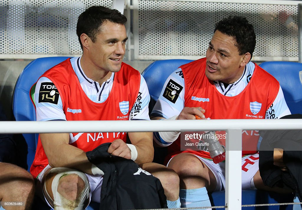 <a gi-track='captionPersonalityLinkClicked' href=/galleries/search?phrase=Dan+Carter+-+Rugby+Player&family=editorial&specificpeople=171299 ng-click='$event.stopPropagation()'>Dan Carter</a> and <a gi-track='captionPersonalityLinkClicked' href=/galleries/search?phrase=Chris+Masoe&family=editorial&specificpeople=540337 ng-click='$event.stopPropagation()'>Chris Masoe</a> of Racing 92 seat on the bench during the Top 14 rugby match between ASM Clermont Auvergne and Racing 92 at Stade Marcel Michelin on December 27, 2015 in Clermont-Ferrand, France.