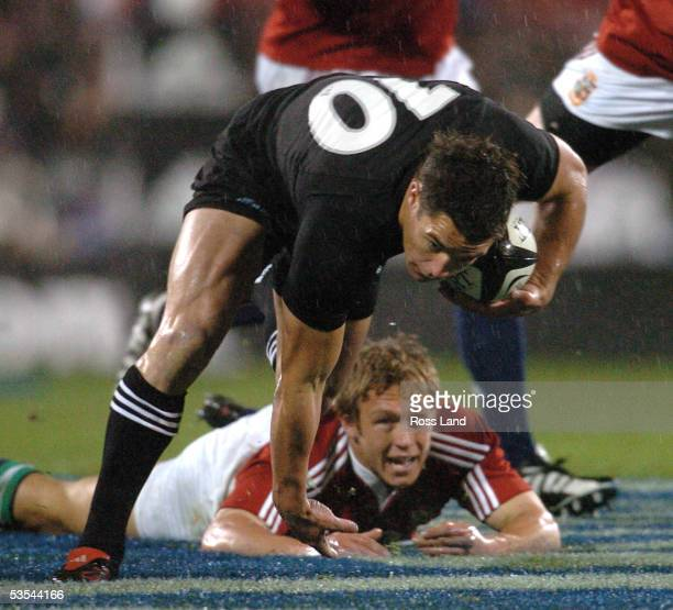 Dan Carter breaks through the tackle of Jonny Wilkinson during the All Blacks V British and Irish Lions rugby test at Jade Stadium Christchurch New...