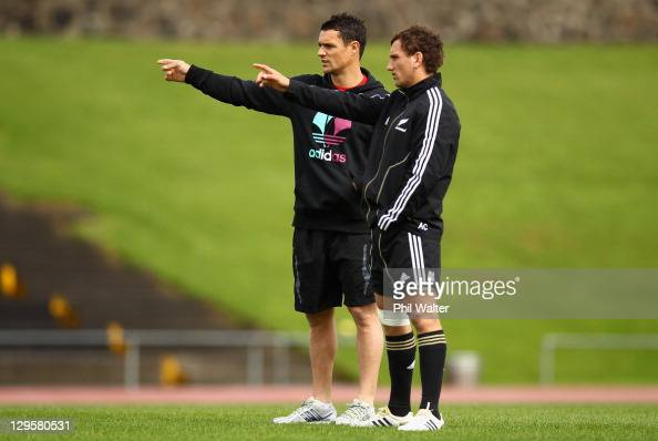 Dan Carter lends some advice to Aaron Cruden of the All Blacks during a New Zealand All Blacks training session at Trusts Stadium on October 19 2011...