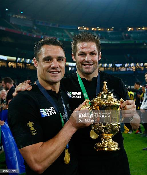 Dan Carter of New Zealand and Richie McCaw of New Zealand pose with the Webb Ellis Cup after victory in the 2015 Rugby World Cup Final match between...