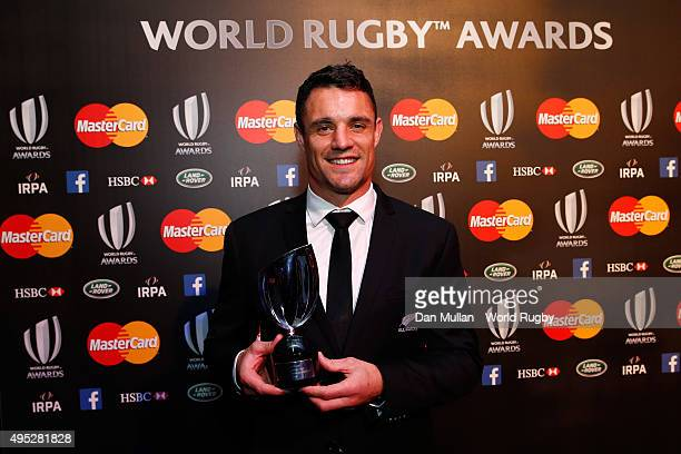 Dan Carter of New Zealand poses after receiving the World Rugby Player of the Year award during the World Rugby Awards 2015 at Battersea Evolution on...