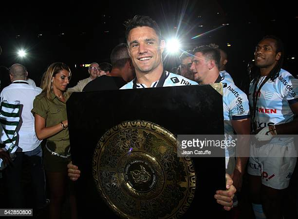 Dan Carter of Racing 92 celebrates winning the Final Top 14 between Toulon and Racing 92 at Camp Nou on June 24 2016 in Barcelona Spain