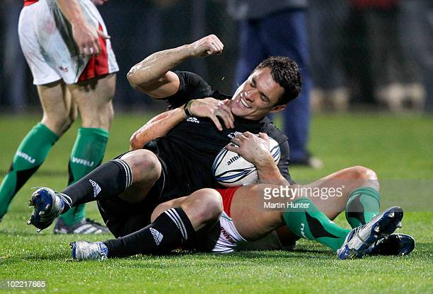 Dan Carter of the All Blacks celebrates scoring his second try during a International rugby match at Carisbrook on June 19 2010 in Dunedin New Zealand