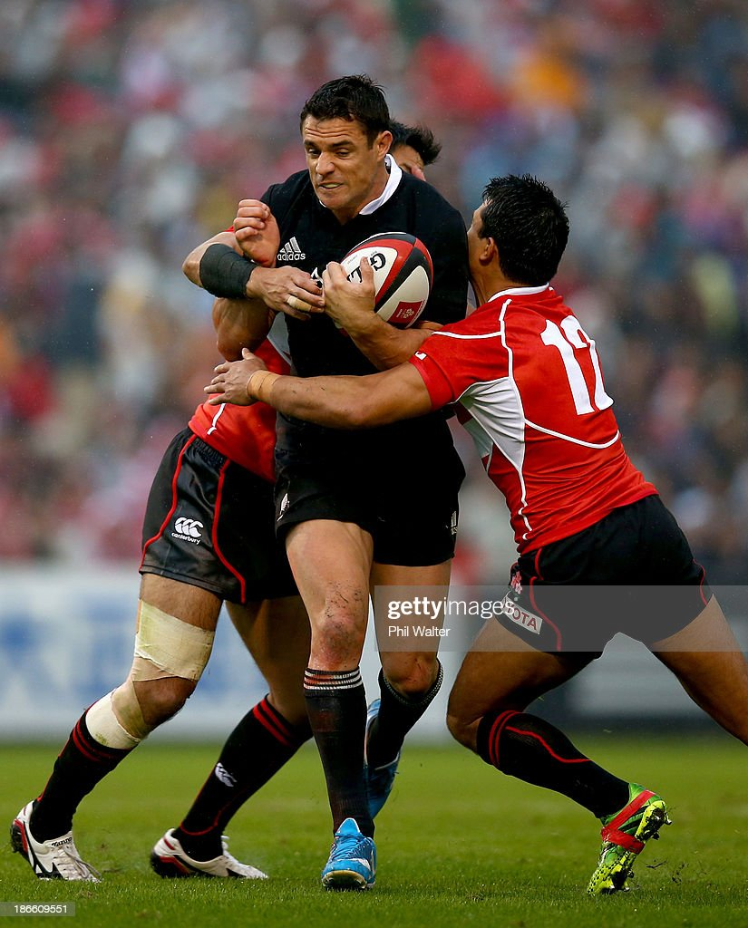 <a gi-track='captionPersonalityLinkClicked' href=/galleries/search?phrase=Dan+Carter+-+Rugby+Player&family=editorial&specificpeople=171299 ng-click='$event.stopPropagation()'>Dan Carter</a> of the All Blacks is tackled by <a gi-track='captionPersonalityLinkClicked' href=/galleries/search?phrase=Craig+Wing&family=editorial&specificpeople=167116 ng-click='$event.stopPropagation()'>Craig Wing</a> of Japan during the International Rugby Test Match between Japan and the New Zealand All Blacks at Prince Chichibu Memorial Rugby Stadium on November 2, 2013 in Tokyo, Japan.