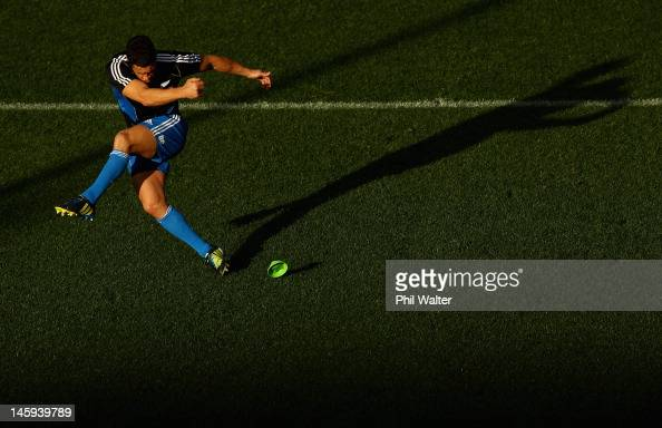 Dan Carter of the All Blacks kicks during the New Zealand All Blacks captain's run at Eden Park on June 8 2012 in Auckland New Zealand