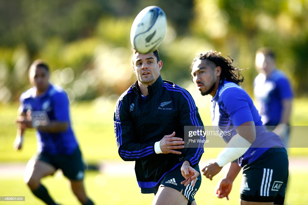 Dan Carter of the All Blacks passes during a New Zealand All Blacks training session at Trusts Stadium on August 11, 2015 in Auckland, New Zealand.