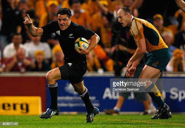 Dan Carter of the All Blacks scores a try during the 2008 Tri Nations series Bledisloe Cup match between the Australian Wallabies and the New Zealand...