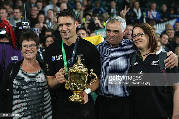 Dan Carter of the New Zealand All Blacks celebrates with his family following victory against Australia in the 2015 Rugby World Cup Final match...