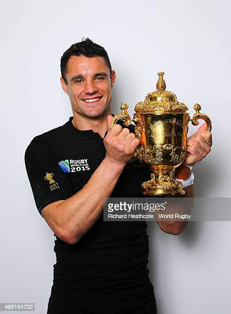 Dan Carter of the New Zealand All Blacks poses with the Webb Ellis Cup after the 2015 Rugby World Cup Final match between New Zealand and Australia...