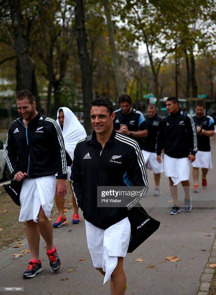 Dan Carter of the New Zealand All Blacks walks back from a pool recovery session on November 4, 2013 in Paris, France.