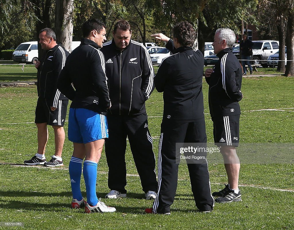 Dan Carter talks to head coach Steve Hansen, Deb Robinson, the team doctor and Peter Gallagher the physio after a New Zealand All Blacks training session held at Saint George's College on September 24, 2012 in Buenos Aires, Argentina.