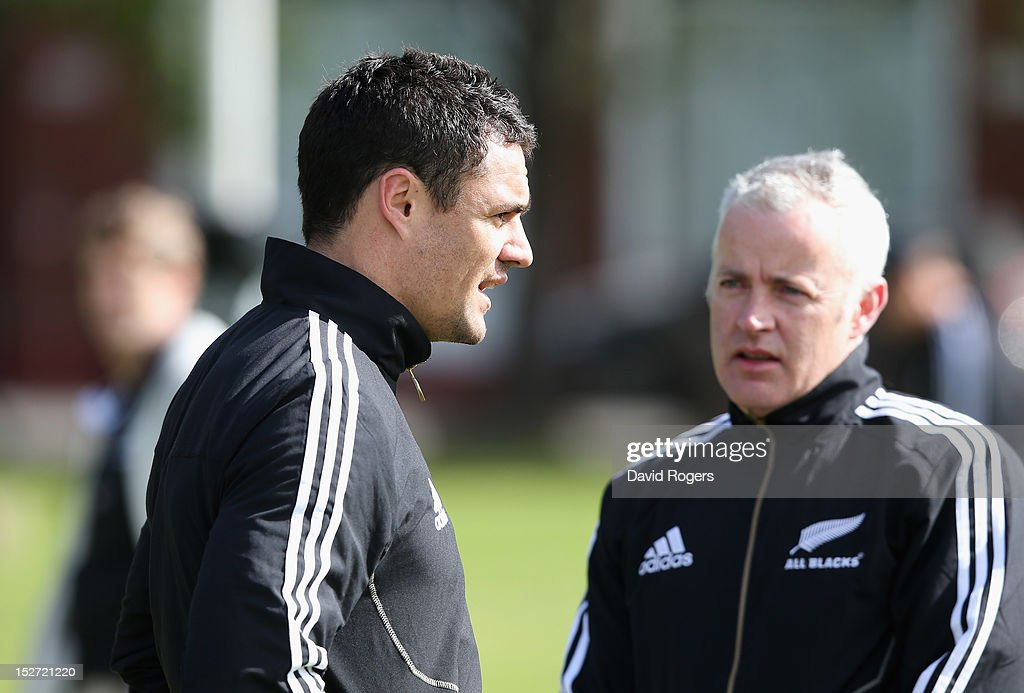 Dan Carter (L) talks to physio Peter Gallagher during a New Zealand All Blacks training session held at Saint George's College on September 24, 2012 in Buenos Aires, Argentina.