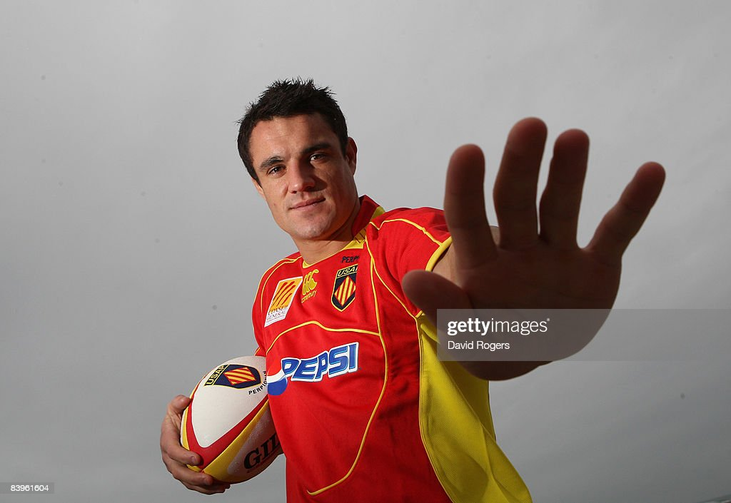 Dan Carter the New Zealand All Black standoff wears his new Perpignan shirt during a photoshoot at Canet December 9 2008 in Perpignan France