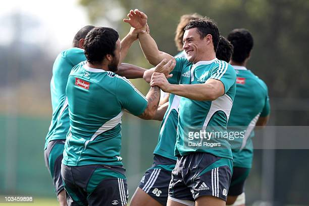 Dan Carter tustles with team mate Piri Weepu during the New Zealand All Blacks training session held at the Witswatersrand University on August 19...