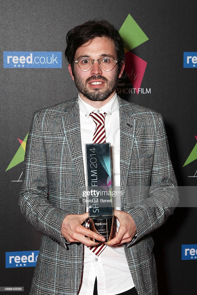 Dan Castella (with his award for his film 'Pitta Patter' Judges Commendation) attends the reed.co.uk Short Film Awards 2014 at BAFTA on May 8, 2014 in London, England.