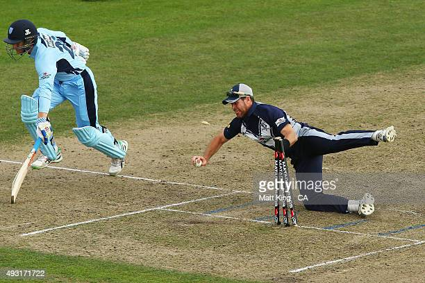 Dan Christian of the Bushrangers attempts to run out Peter Nevill of the Blues during the Matador BBQs One Day Cup match between New South Wales and...