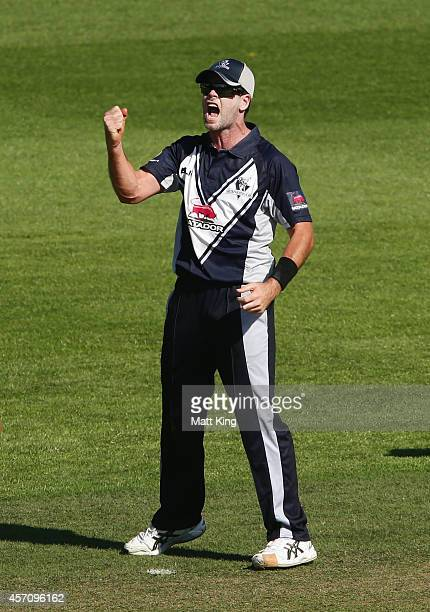 Dan Christian of the Bushrangers celebrates running out Peter Nevill of the Blues during the Matador BBQs One Day Cup match between Victoria and New...