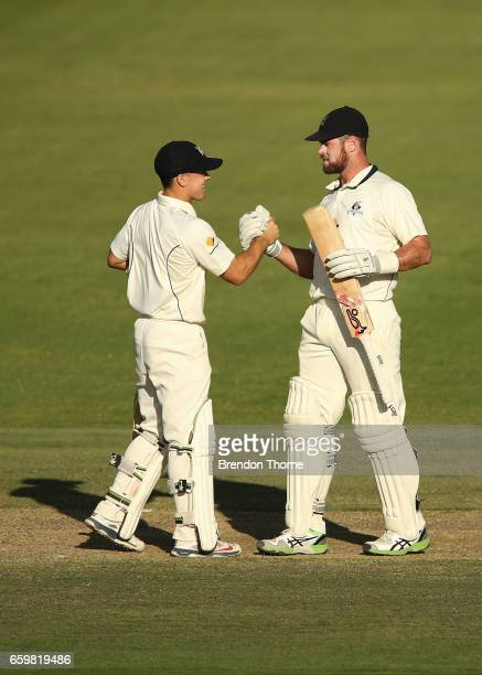 Dan Christian of the Bushrangers celebrates scoring his half century with team mate Seb Gotch during the Sheffield Shield final between Victoria and...