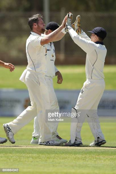 Dan Christian of the Bushrangers celebrates with his team mate Seb Gotch after taking the wicket of Adam Voges of the Warriors during the Sheffield...