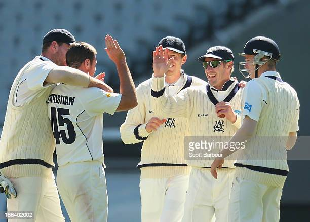 Dan Christian of the Bushrangers congratulates David Hussey after he took a catch off his bowling to dismiss Will Bosisto of the Warriors during day...