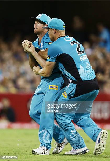 Dan Christian of the Heat avoids a collision with Andrew Flintoff to catch Tim Paine of the Hurricanes during the Big Bash League match between the...