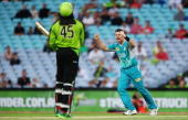 Dan Christian of the Heat celebrates after claiming the wicket of Chris Gayle of the Thunder during the Big Bash League match between the Sydney...