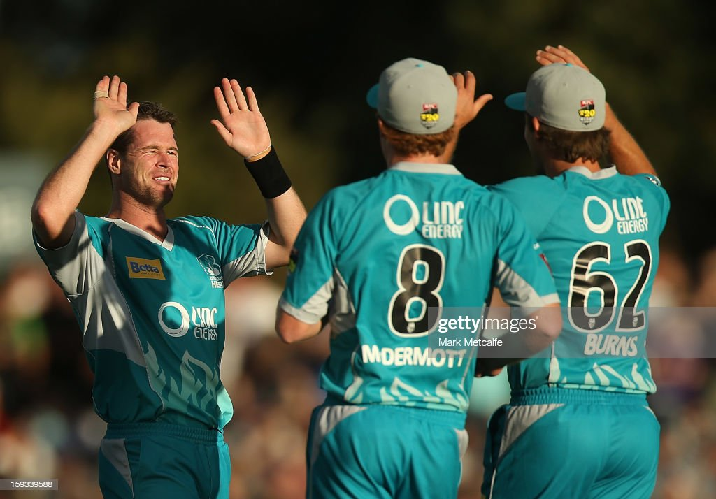 Dan Christian of the Heat celebrates with teammates Alister McDermott and Joe Burns after taking the wicket of Travis Birt of the Hurricanes during the Big Bash League match between the Hobart Hurricanes and the Brisbane Heat at Blundstone Arena on January 12, 2013 in Hobart, Australia.