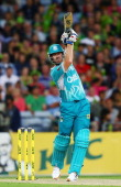 Dan Christian of the Heat hits a six during the Big Bash League match between Sydney Thunder and Brisbane Heat at ANZ Stadium on January 8 2014 in...