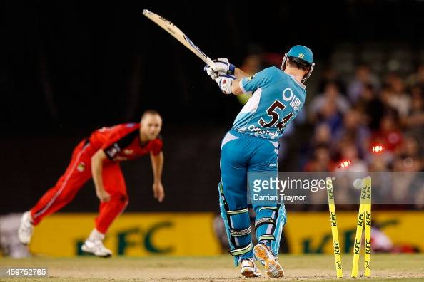 Dan Christian of the Heat is bowled during the Big Bash League match between the Melbourne Renegades and Brisbane Heat at Etihad Stadium on December...