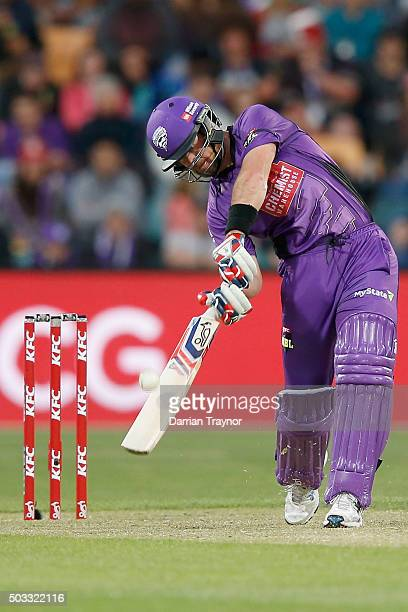 Dan Christian of the Hobart Hurricanes hits a 6 off the bowling of Nathan Rimmington of the Melbourne Renegades during the Big Bash League match...