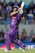 Dan Christian of the Hobart Hurricanes watches the ball fly over the fence during the Big Bash League match between the Hobart Hurricanes and the...