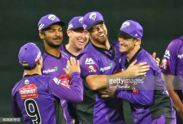 Dan Christian of the Hurricanes celebrates with Kumar Sangakkara and George Bailey after running out Chris Hartley of the Thunder during the Big Bash...