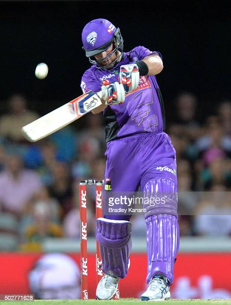 Dan Christian of the Hurricanes hits the ball over the boundary for a six during the Big Bash League match between the Brisbane Heat and Hobart...