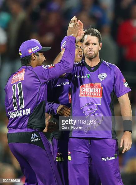 Dan Christian of the Hurricanes is congratulated by team mates after getting the wicket of Lendl Simmons of the Heat during the Big Bash League match...