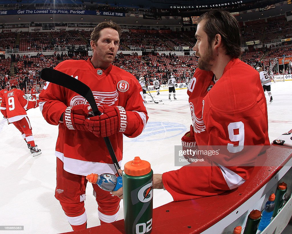 Dan Cleary and Henrik Zetterberg of the Detroit Red Wings wears jersey in honor of Gordie Howe on his 85th birthday during warm ups before a NHL game...