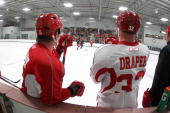 Dan Cleary and Kris Draper of the Detroit Red Wings watch a drill along the boards during the begining of training camp on September 18 2010 at...