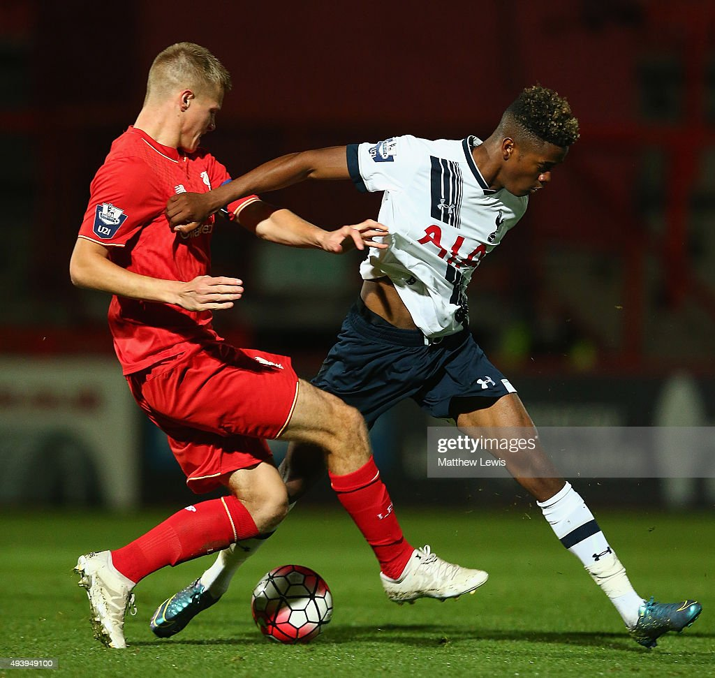 Dan Cleary of Liverpool and Shayon Harrison of Tottenham Hotspur challenge for the ball during the Barclays U21 Premier League match between...