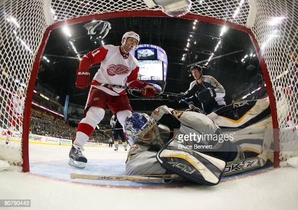 Dan Cleary of the Detroit Red Wings looks for a rebound off Dan Ellis of the Nashville Predators on April 20 2008 during game six of the Western...